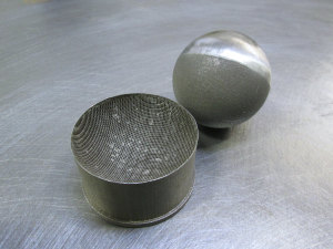 You can see the intense support structures that protected the sphere during building. Half of the sphere has since been polished while the remainder of the sphere shows signs of where the supports left off.