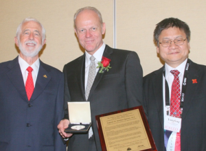 San Diego, October 29, 2014: LIA Executive Director Peter Baker, 2014-Schawlow Awardee Reinhart Poprawe and 2014 Past  LIA President Yongfeng Lu.