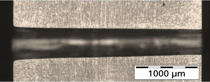 Figure 7. Longitudinal section of a drilled hole in 3 mm thick stainless steel without any recast layer