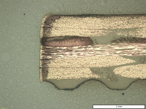Figure 3. Cross-section of CFRP with laser wavelength-absorbing additives, cut at 5 kW laser power