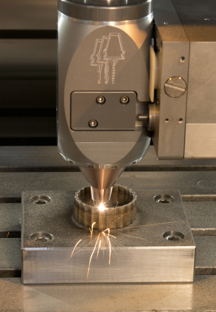 Featuring the nozzle © Hybrid Manufacturing Technologies