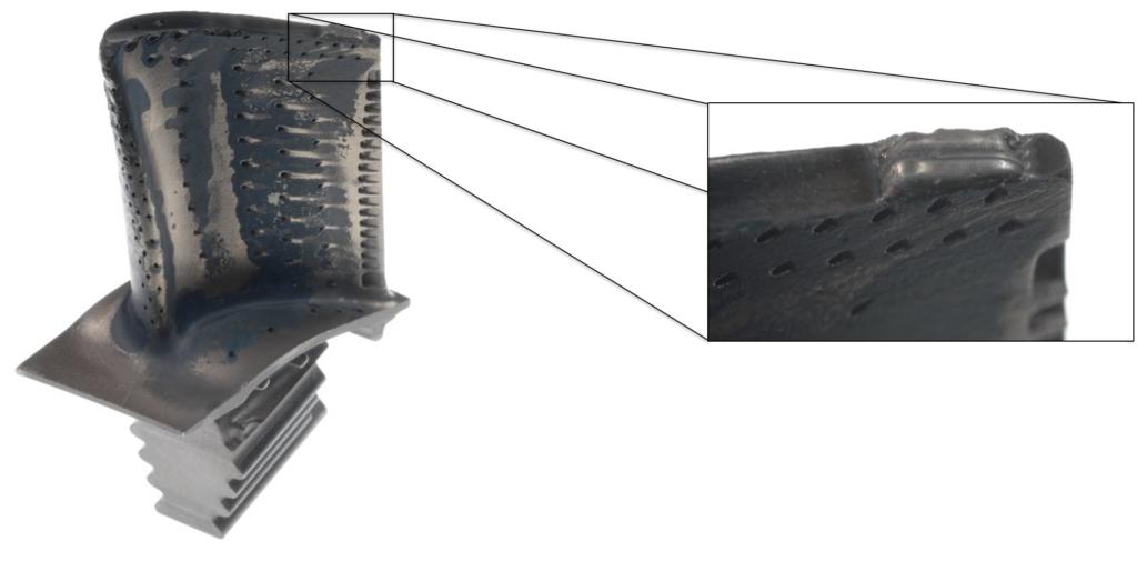 Cladding on a turbine blade tip